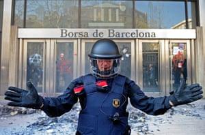 Barcelona: A police officer blocks