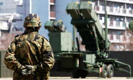 JSDF soldier near Patriot Advanced Capability-3 (PAC-3) missiles at the Defence Ministry in Tokyo