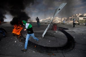 Land Day protests: Masked Palestinians clash with Israeli troops