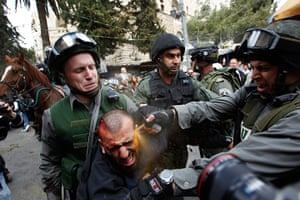 Land Day protests: Israeli police officers use pepper spray an injured Palestinian protester