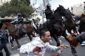 Land Day protests: Israeli mounted policemen move crowds of Palestinian protestors, Jerusalem