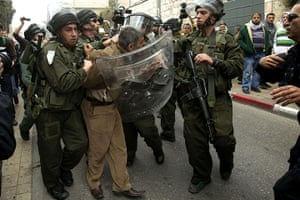 Land Day protests: Palestinian man is arrested by Israeli policemen during a  Jerusalem