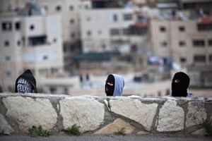 Land Day protests: Masked Palestinians demonstrators take cover in Issawiyeh, Jerusalem
