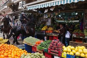 Land Day protests: Israeli police officers ride through fruit market,  Jerusalem