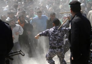 Land Day protests: Members of the Hamas security forces restrain Palestinian protesters