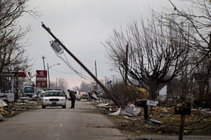 Midwest tornado: A police vehicle blocks entry to the town of Holton, Indiana