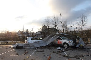 Midwest tornado: Cars and debris are strewn in front of of Henryville High School in Indiana