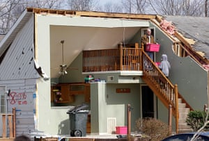 Midwest tornado: Residents carry out boxes from their damaged home in Henryville, Indiana