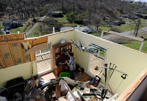Midwest tornado: Aman helps to clean up a house in Harrison, Tennessee