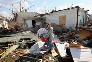Midwest tornado: A woman helps a friend rescue possessions in Henryville