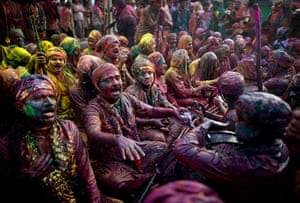 Lathmar Holi : Indian Hindu worshippers covered in various coloured powders sing prayers