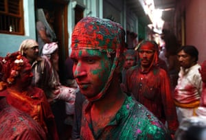Lathmar Holi : A man is covered with coloured powder called Gulal in Barsana