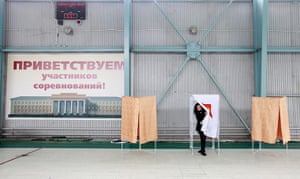Russian election: Stavropol: A woman leaves a voting booth