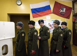 Russian election: Moscow: Soldiers wait for their turn to vote