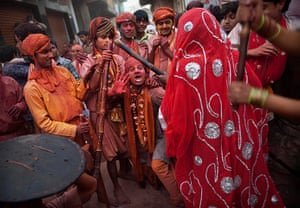 Lathmar Holi : A man from Nandgaon shouts as he is about to be hit by a woman from Barsana