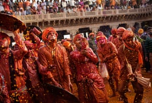 Lathmar Holi : Indian Hindu worshippers from Barsana are sprayed with coloured water