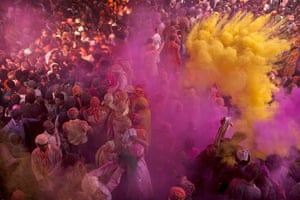 Lathmar Holi : Indian Hindus worshippers are covered in powder