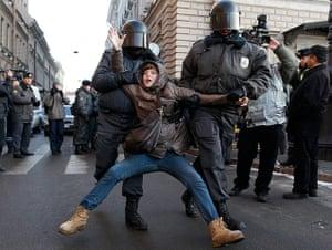 Putin protest: Russian police detain a participant