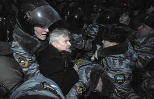 Putin protest: Police officers detain the Other Russia movement leader Eduard Limonov