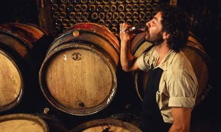Sampling wine from barrel