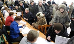Russians queue to register for voting at a polling station in Moscow