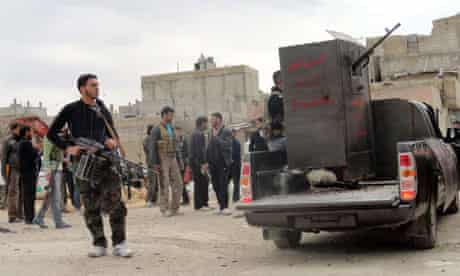 Members of Free Syrian Army are seen deployed in al-Bayada, Homs