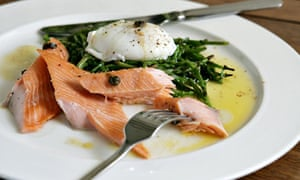 Tea-smoked salmon on sautéed samphire with a poached egg and brown butter