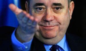 Alex Salmond gestures to journalists