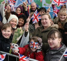 Wellwishers await the arrival of the royal party