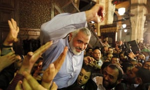 Hamas leader Ismail Haniyeh is carried by supporters