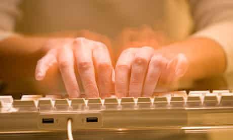 Man typing on computer keyboard