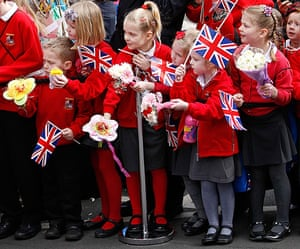 Royals in Leicester: Schoolchildren wait to see The Queen during her visit to the Cathedral