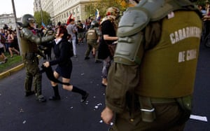 24 hours in pictures: Santiago, Chile: Activists clash with riot police