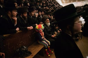 24 hours in pictures: Jerusalem: A child dressed in a clown costume at a synagogue