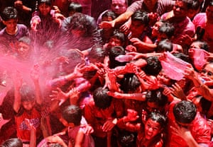 24 hours in pictures: Ahmedabad, India: Devotees during a Holi celebration