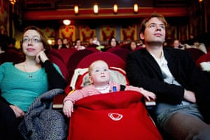 24 hours in pictures: Amsterdam, The Netherlands: Parents and their babies attend a movie