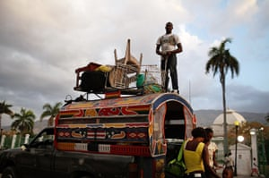 24 hours in pictures: Port-au-Prince, Haiti: A family leaves a tent camp with their belongings