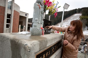 Japan tsunami: Miho Suzuki prays at a shrine to the memory of her daughter Hana