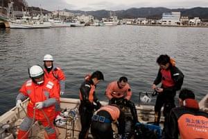 Japan tsunami: Divers search the harbour for bodies, Kesennuma, Japan