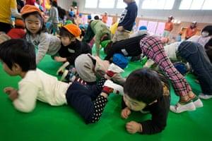 Japan tsunami: Children play in the Red Cross' 'Smile Park', Fukushima prefecture, Japan