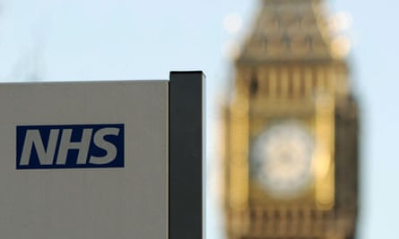 An NHS sign at St Thomas's hospital, London, with Big Ben in the background