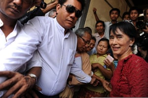 Burma elections: Aung San Suu Kyi is surrounded by supporters and journalists