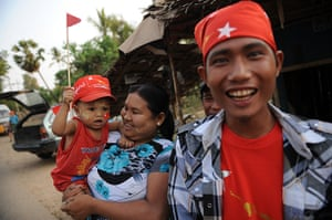 Burma elections: Supporters wait on the side of a road in Kawhmu