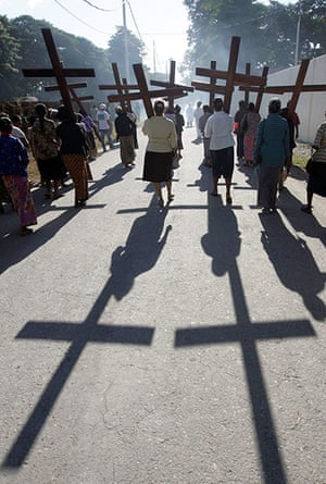Palm Sunday: East Timorese Catholic women carry wooden crosses in a procession in Dili