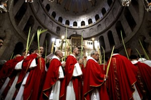 Palm Sunday: Clergy circle the aedicule during the Palm Sunday procession in Jerusalem