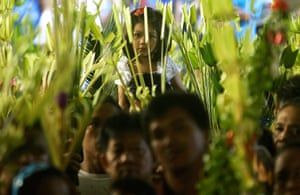 Palm Sunday: A Filipino Catholic girl waits for the blessing of palm fronds in Manila