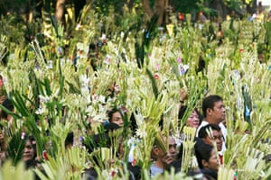 Palm Sunday: Devotees wave palm fronds in Baclaran, Manila
