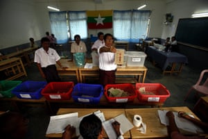 Burma elections count: Election officials count the ballots at a polling station in Mayangone