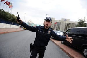 Syrian protests: A Turkish police officer tries to stop supporters of President Assad