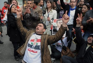 """Syrian protests: Pro-Assad demonstrators gather outside the """"Friends of Syria"""" conference"""